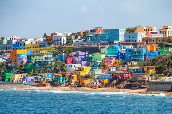 Colourful houses line the hillside over looking the beach in San Juan, Puerto Rico